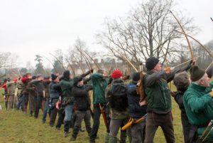Archers shooting arrows towards the mark