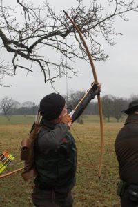Shooting an arrow into the air towards the mark